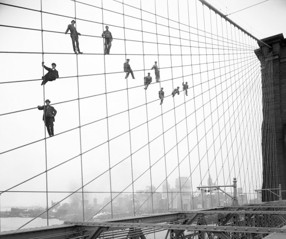 Painters suspended on cables of the the Brooklyn Bridge, on October 7, 1914. (Eugene de Salignac-Courtesy NYC Municipal Archives)