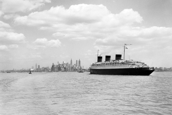 The S.S. Normandie, seen from a Staten Island ship steaming through upper bay on its way to a river pier built for it, ca. 1935-1941. (Courtesy NYC Municipal Archives)