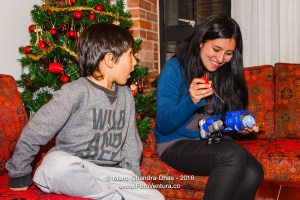 Bogota, Colombia - Mother Helps Son with New Toy