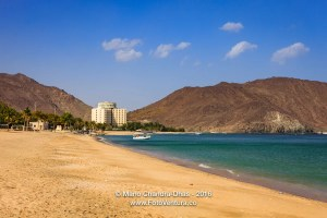 Khor Fakkan, UAE: sandy beach and hotel on Arabian Sea.