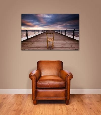 canvas art hanging above chair