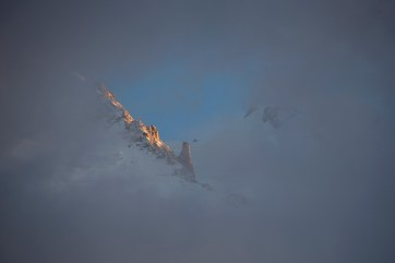 Part of the Aiguille du Midi peeks out from a gap in the cloud at sunset. Taken from the valley bottom. Canon 5D MkIII, Canon EF 70-300mm f/4-5.6 IS USM at 300mm, ISO 100, 1/100 sec at f/5.6. Handheld. October. © Stuart Holmes