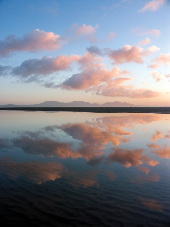 Sunset reflections in pools left by the outgoing tide. Konica Minolta A200 at 29mm eq., 1/30 sec @ f/5.6, ISO 50. © Simon Kitchin