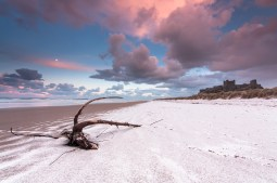 Snow on the beach, Bamburgh Castle in December. Canon EOS 450D, Sigma 10-20mm at 10mm, ISO 100, 1s at f/14, Tripod. © Anita Nicholson.