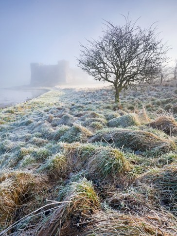 Carew Castle Frosty Morning. Canon 5D Mark II, Canon EF 17-40mm at 17mm, ISO 100, 1/13s at f/13. Tripod, ND Grads. January © Drew Buckley