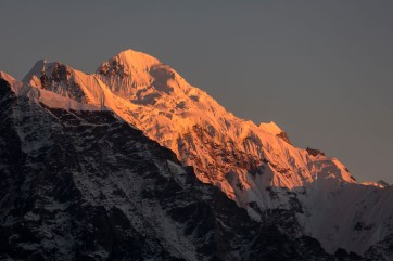 Himalaya glow on the peaks at sunset, taken from Yangma Village. Canon 5D MkIII, 70-300mm at 244mm, ISO 100, 1/100 sec at f/5.6, hand held. © Stuart Holmes.