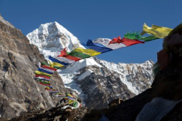 Prayer flags flutter on top of a pass – issuing the prayers out to the world with the wind. Canon 5D MkIII, 24-105mm at 67mm, ISO 100, 1/500 sec at f/7.1. © Stuart Holmes.