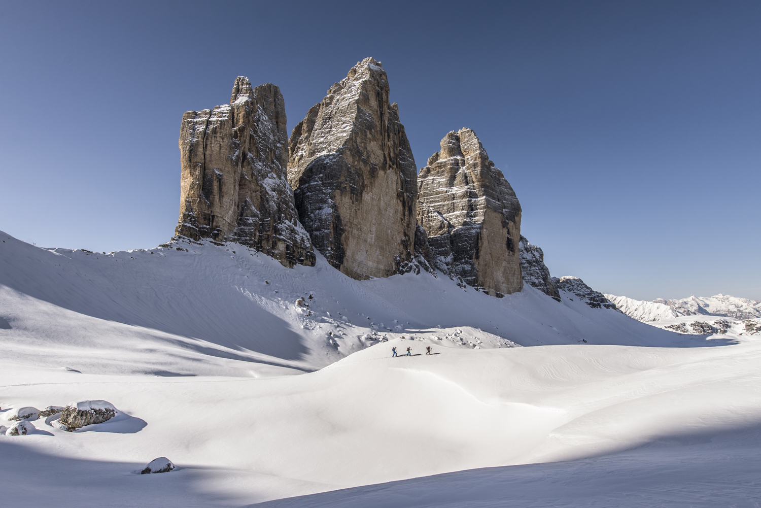A story of three - ski tourers at the Tre Cime. Nikon D610, 14-24mm at 18mm, ISO 100, 1/640s at f/7.1. March. © James Rushforth.