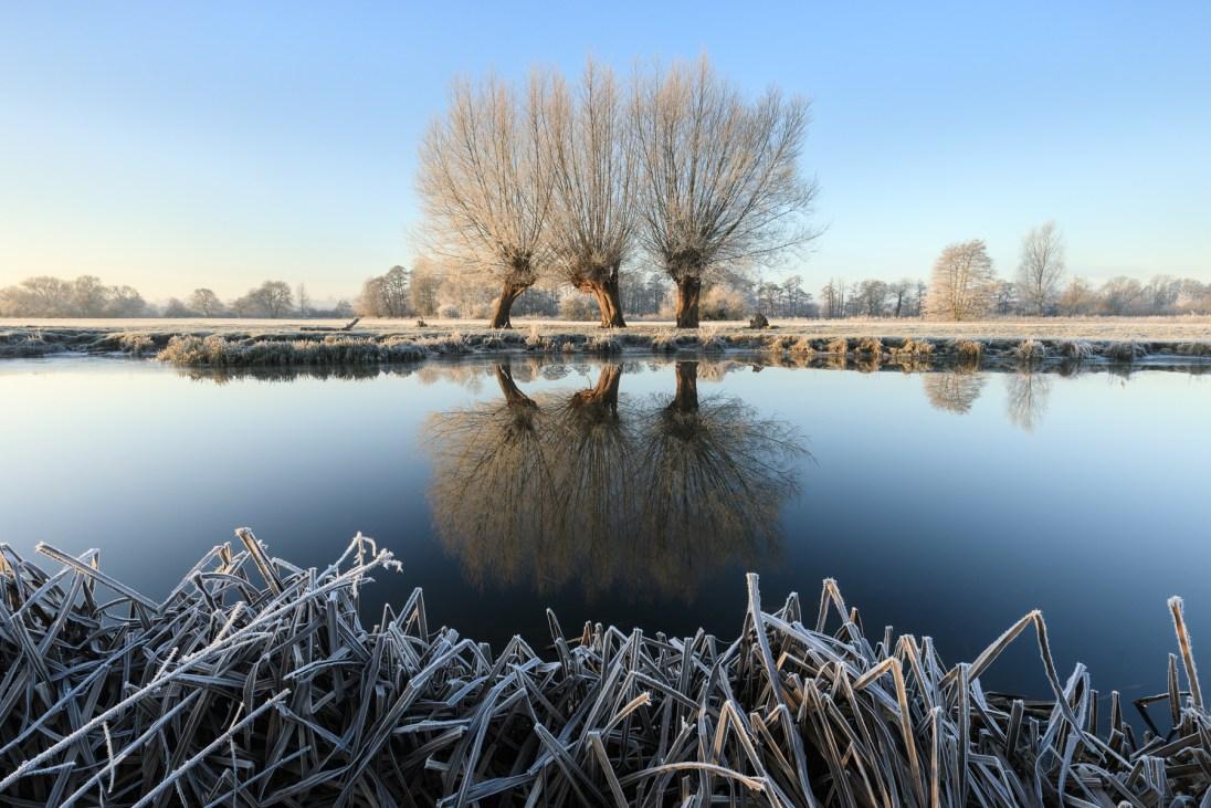 A frostbitten River Stour near Flatford, Suffolk. Canon 5D MkIV, Canon 16-35mm f/2.8 @ 17mm, ISO 100, 1/6s @ f/16, Lee Filters Landscape Polariser, Gitzo Tripod, December. ©Justin Minns/National Trust