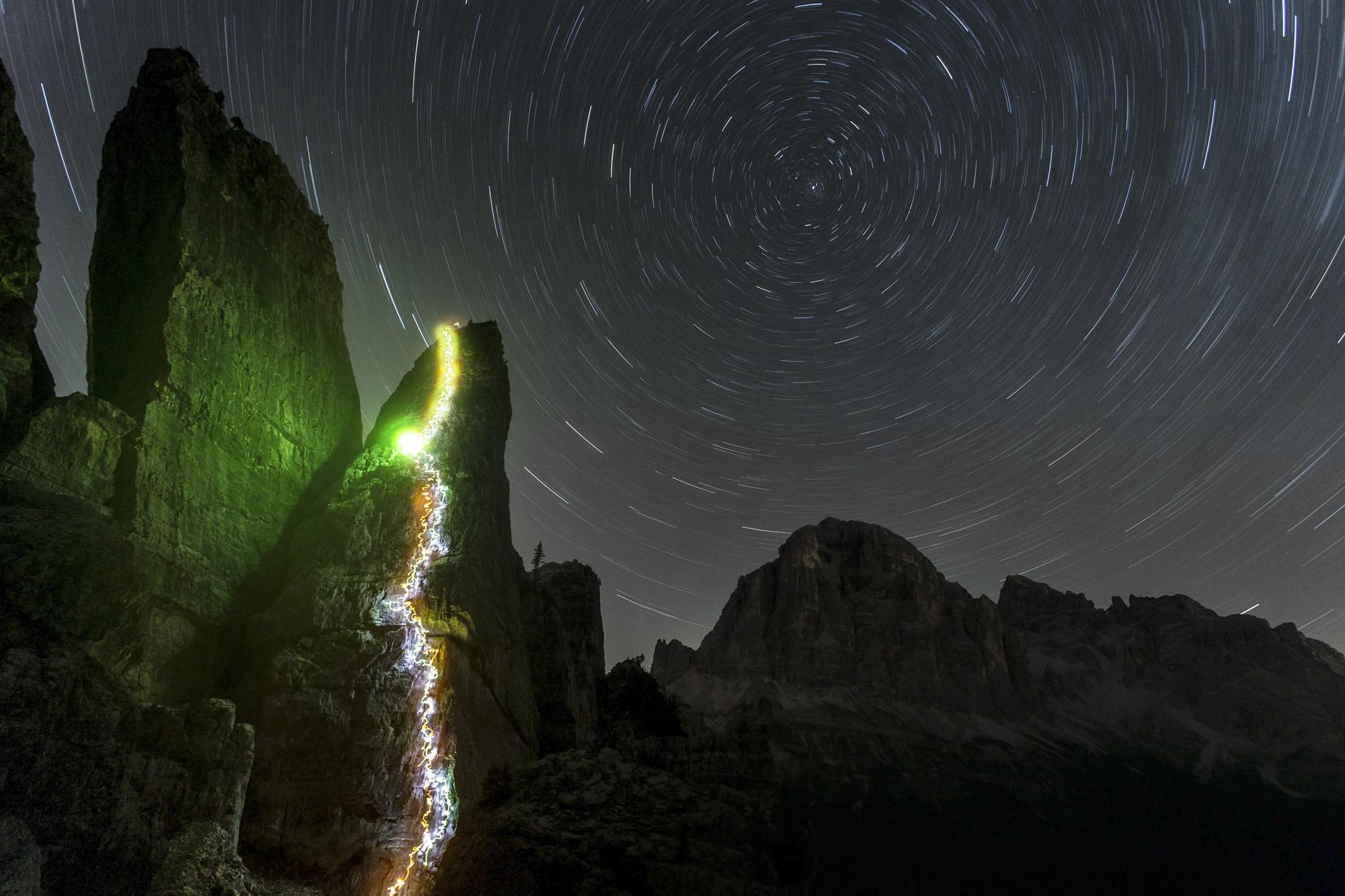Patrick Deacon and Lynne Hempton making a night ascent of Torre Quarta Bassa. Nikon D610, 16-35mm at 16mm, ISO 100, 36 mins at f/5.6, tripod, September. ©James Rushforth