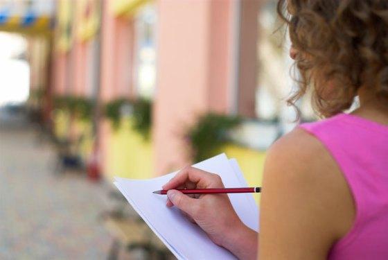 woman-writing-on-street