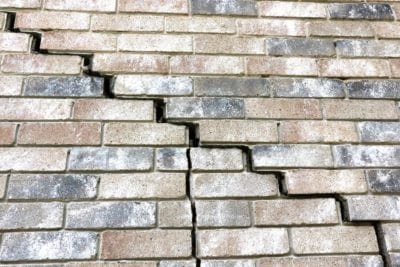 brick wall with stair step crack