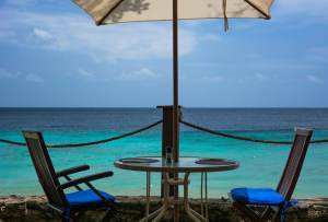 Comfortable beach chairs faicn gthe ocean at Tropical Sunset Anguilla
