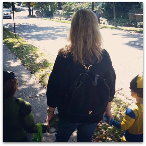 That's me taking the kids trick-or-treating with the Etienne Aigner Porter Backpack.