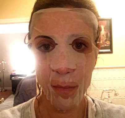 Proof that I am willing to embarrass myself, here I am with a single use sheet mask. You leave it on for about 15-20 minutes (and scare the crap out of your family) until the ingredients soak into your skin and the sheet is nearly dry. My skin was freaking fabulous when I took it off! Snail goo is GOD.