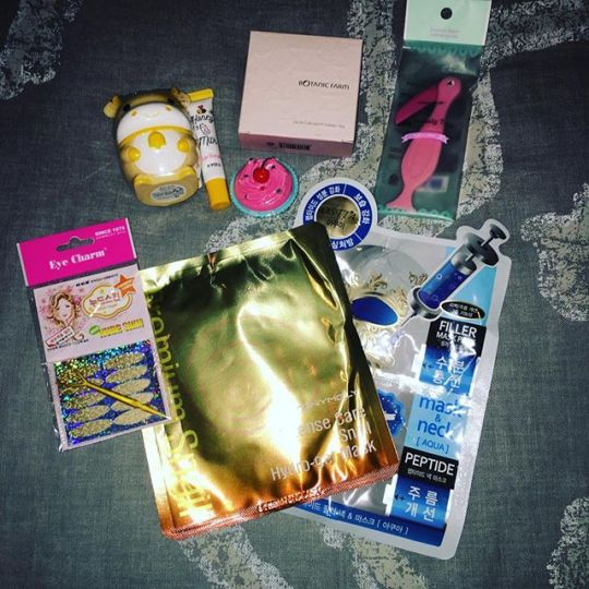 Korean beauty products on a bed masks lotions
