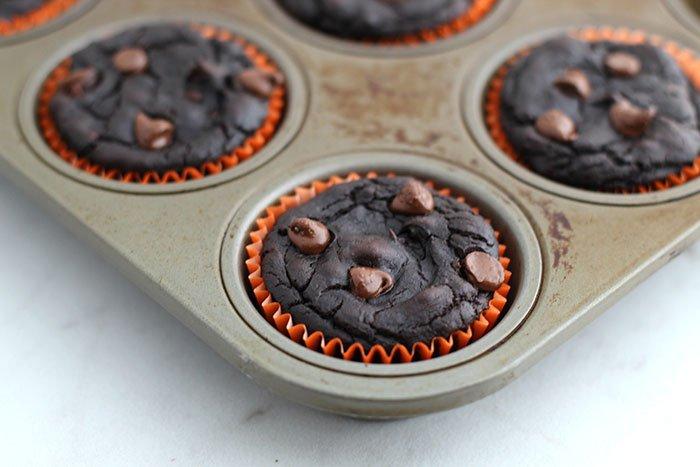Healthy Pumpkin Chocolate Brownie Muffins in pan orange muffin cups