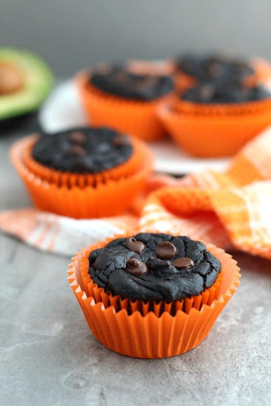 Healthy Pumpkin Chocolate Brownie Muffins in orange paper muffin cups