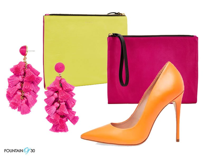 bright neon colors hot pink earrings yellow and pink wrist bag and orange high heel pumps