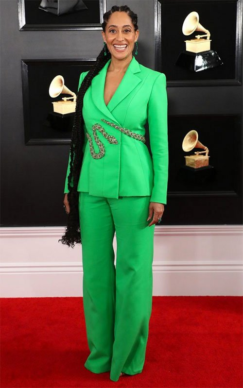 Tracee Ellis Ross in Ralph & Russo bright lime green jacket with snake detail and wide leg pants