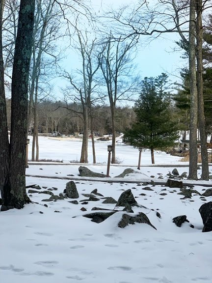 A view of the frozen lake at Woodloch Pines Resort