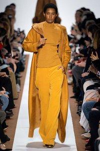 monochrome mustard coat pants turtleneck akris