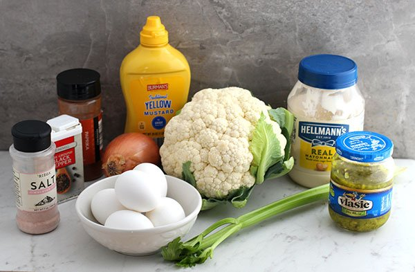 low carb cauliflower potato salad recipe ingredients on a marble table