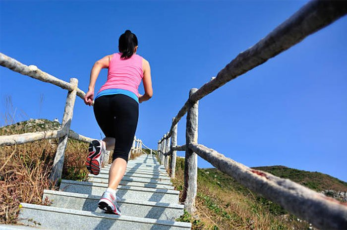 exercise Weight-Bearing Aerobics woman running up stairs outdoors blue sky