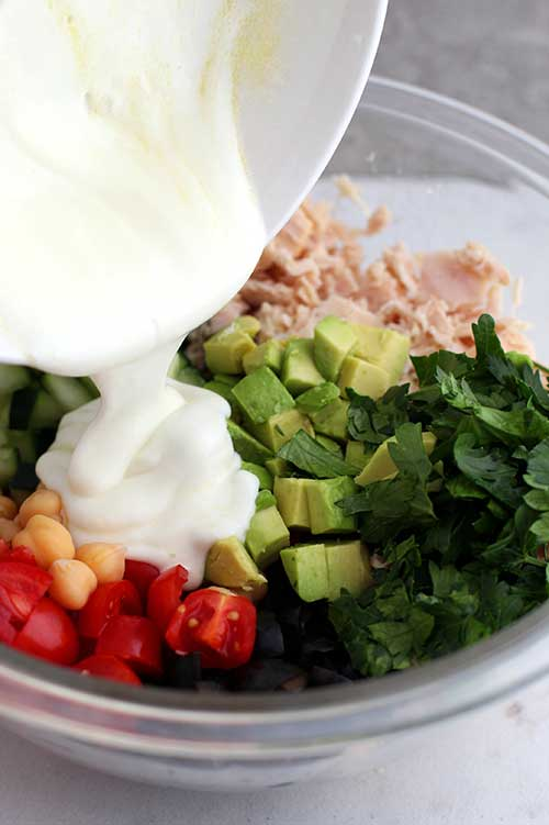 Greek nonfat yogurt and lemon over tuna salad and vegetables