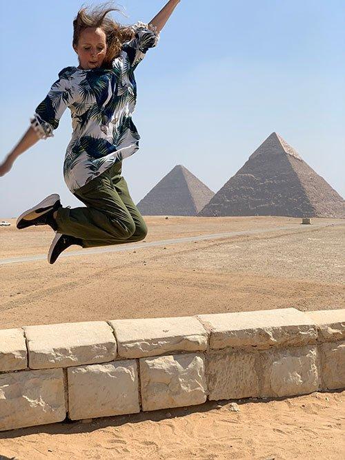 Giza Pyramids Egypt woman jumping fountainfo30