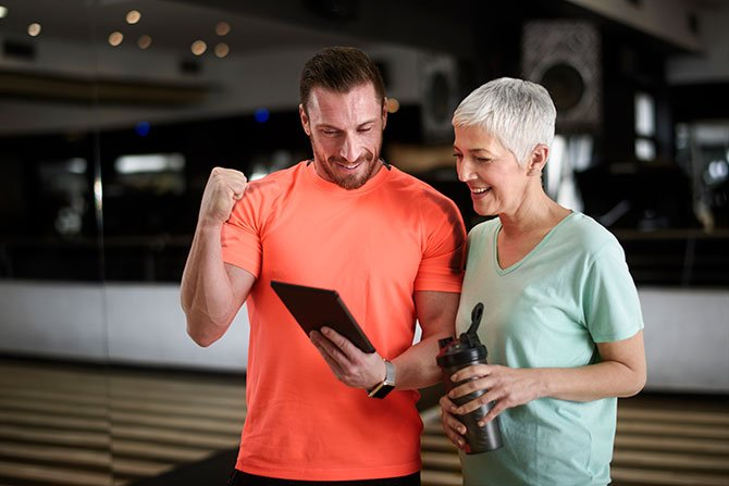 personal fitness trainer with middle age woman fountainof30