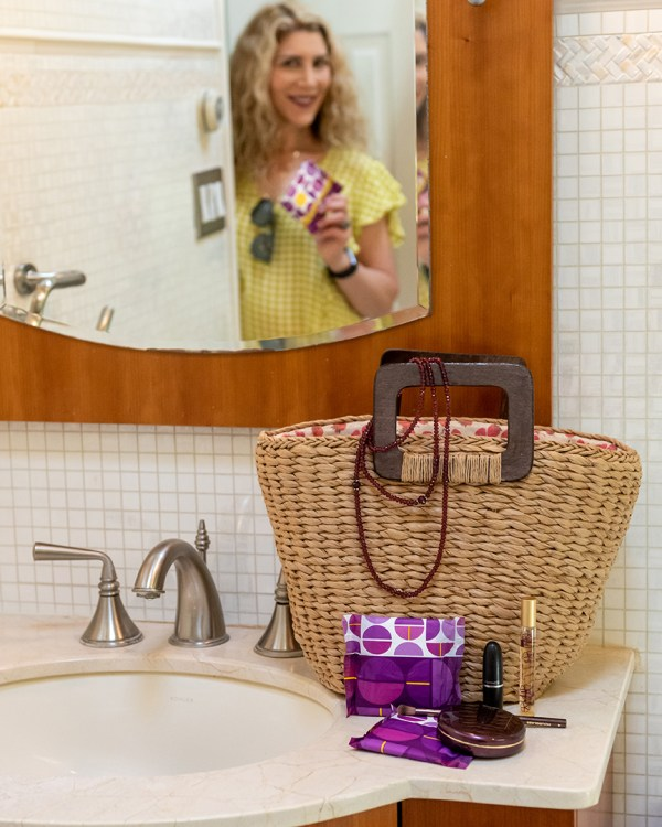 one by poise package with tote bag on bathroom sink fountainof30