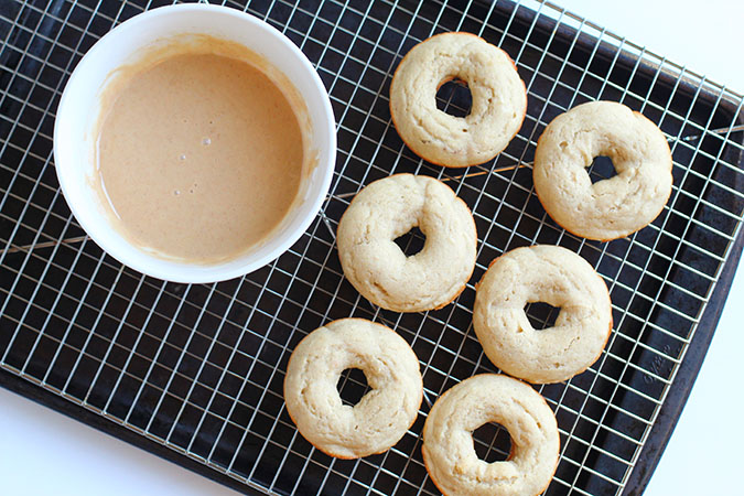 baked donuts with glaze in bowl on a rack foiuntinof30