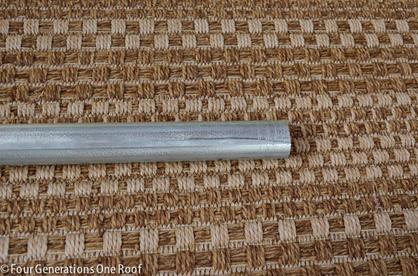 galvanized pipe on outdoor brown tweed rug