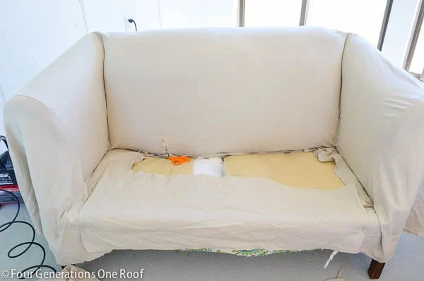 loveseat with pottery barn slipcover stapled to couch