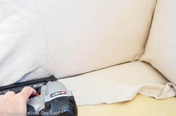 Pottery Barn slipcover used to reupholster a couch with staple gun and staples