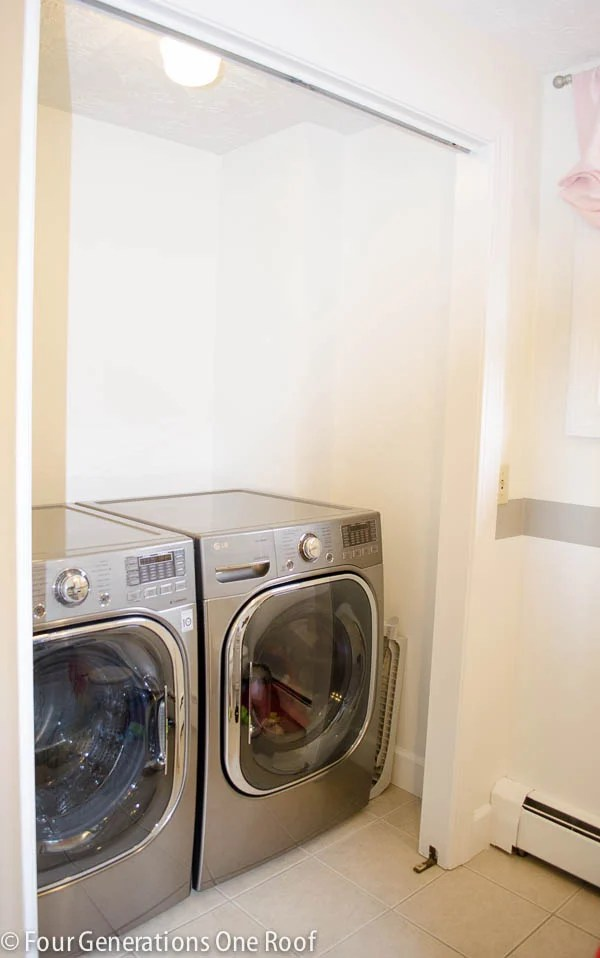 laundry closet with side by side washer dryer white paint