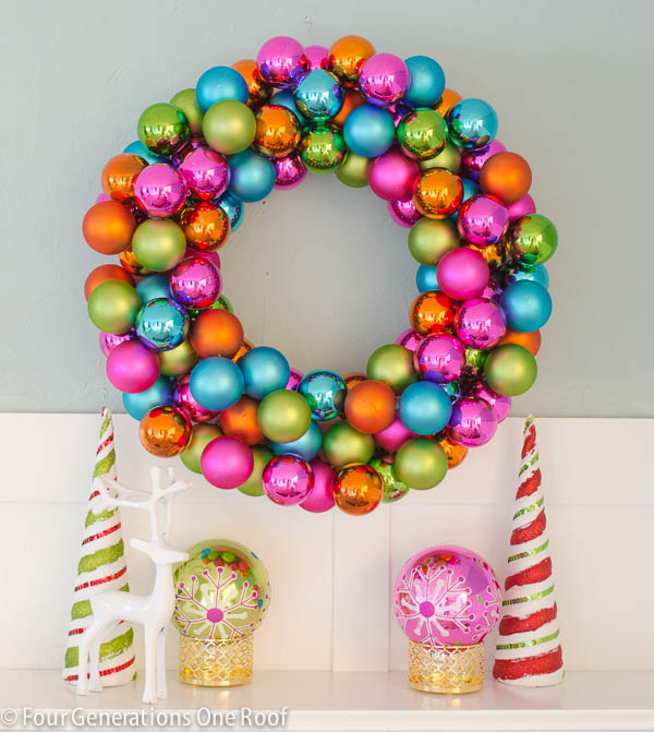 Colorful Christmas ornament wreath, candy cane trees, white floating shelf