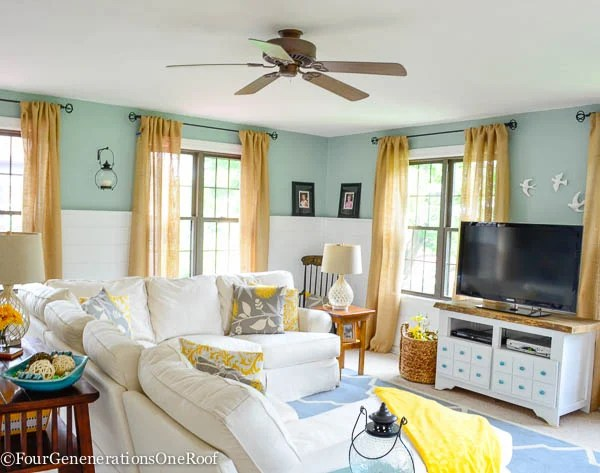 blue and white living room, burlap curtains, clean windows, blue rug