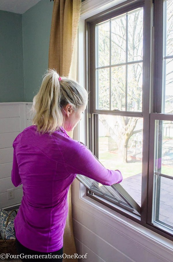 girls in purple shirt cleaning windows with vinegar and diaper cloth