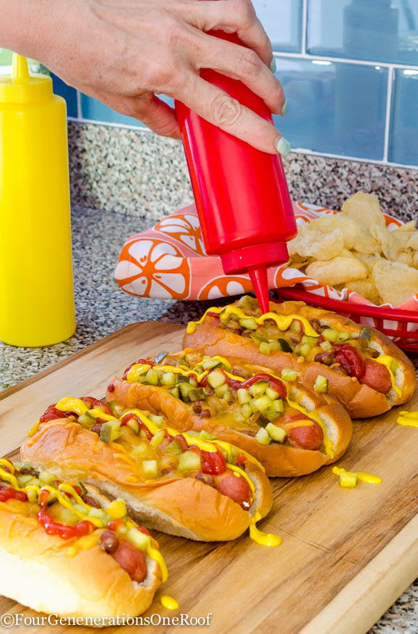 Kings Hawaiian hot dog rolls, hot dog, baked beans, with butter spread on top, cookie sheet lined with tin foil, relish, ketchup