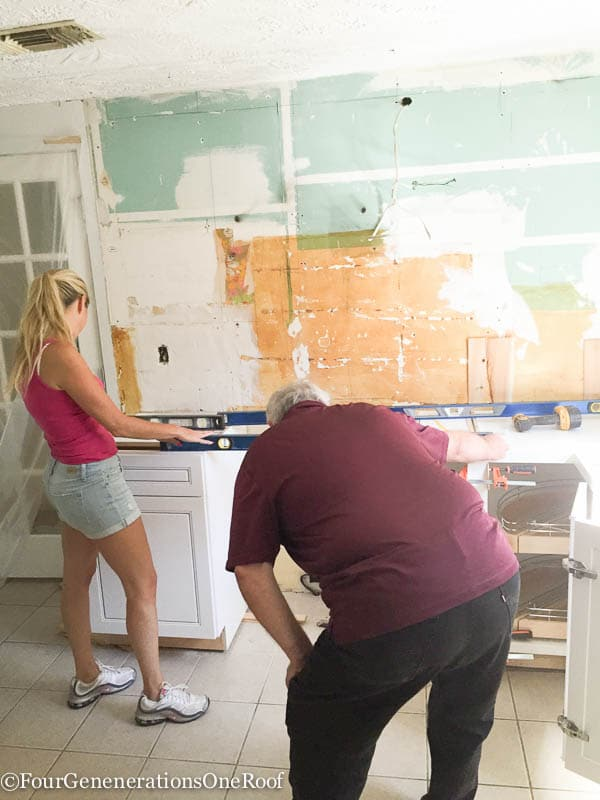 Our kitchen renovation series {installing new cabinets}