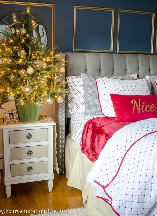 Our Red + White Christmas bedroom featuring black and white polka dot flannel sheets, red velvet blanket, red and white diamond coverlet and black gingham checkered pillow covers