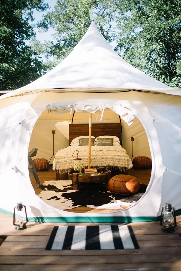 fancy white outdoor tent for camping with bed inside