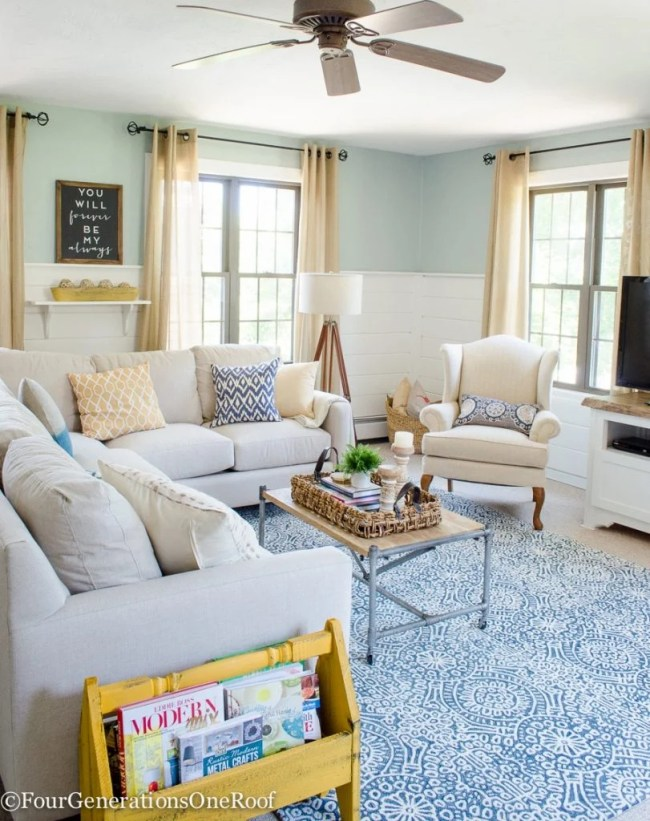 White sectional, blue rug, white wingback, rainwash paint color