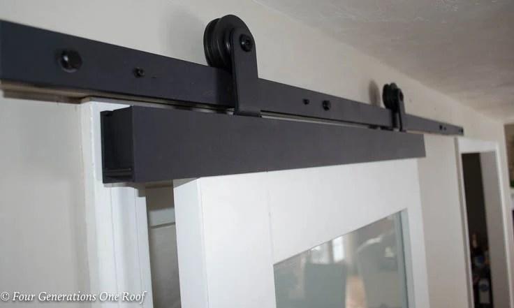 Black barn door sliding track hardware, white barn door with glass, Barn Door Installation without Removing Door Trim