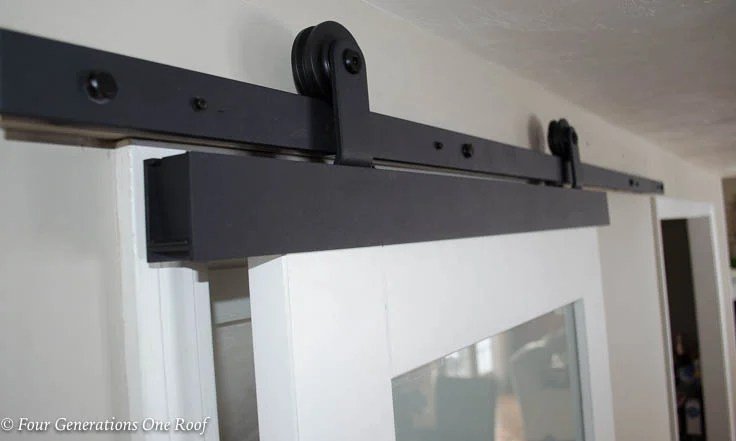 Black barn door sliding track hardware, white barn door with glass, Barn Door Installation without Removing Door Trim