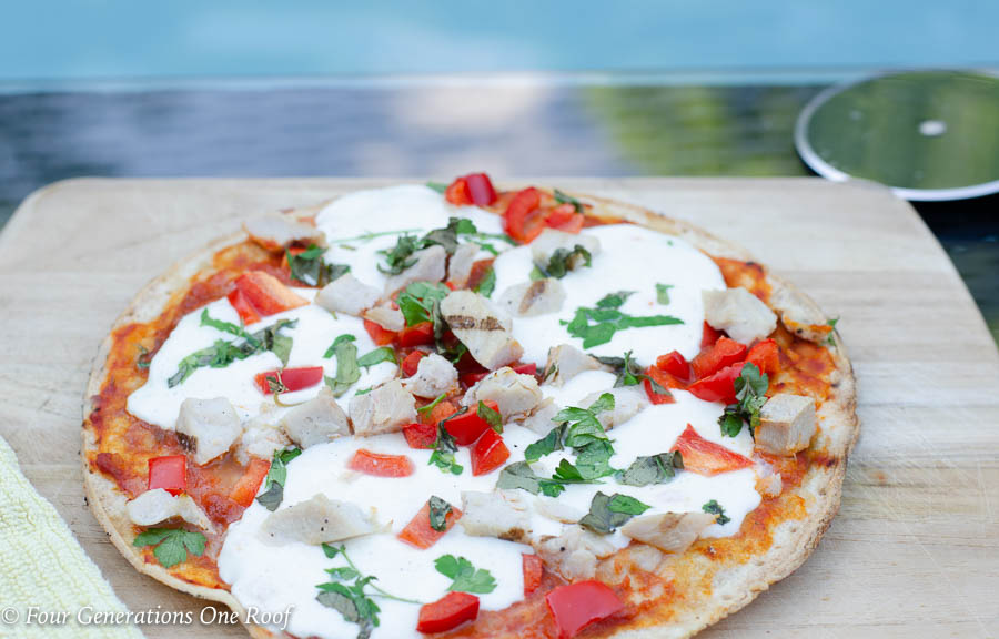frozen cauliflower pizza crust, marinara or pasta sauce, fresh mozzarella, chicken, peppers , basil and parsley