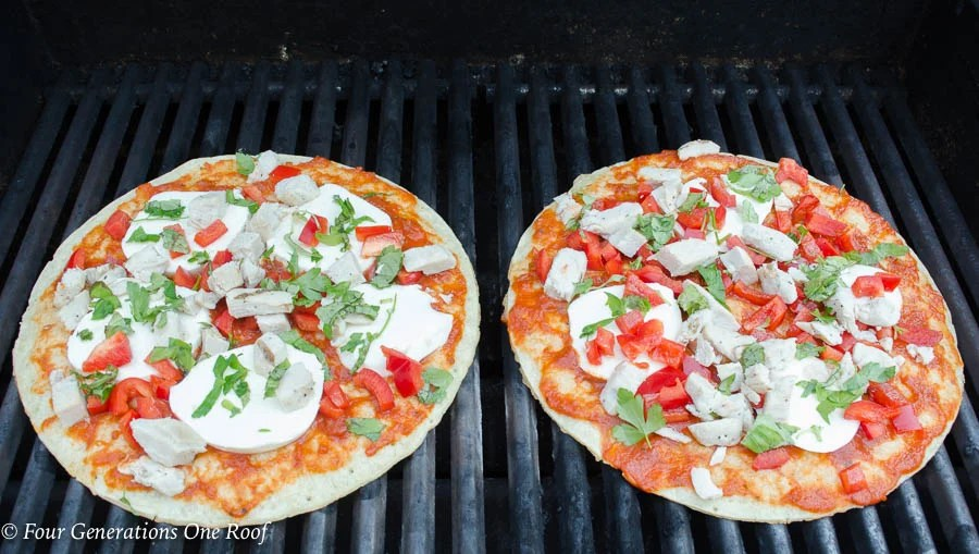 frozen cauliflower pizza crust, marinara or pasta sauce, fresh mozzarella, chicken, peppers , basil and parsley on grill grates