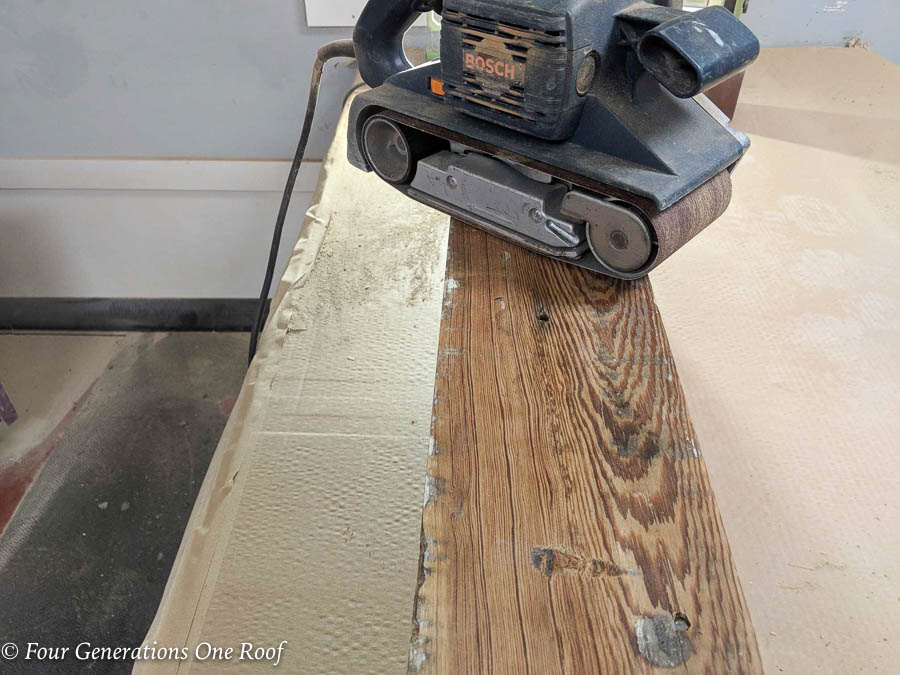 Southern Pine Wood beam being sanded in a sanding machine